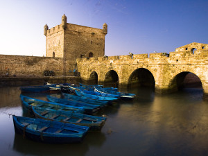 Travel photograph of colorful boats in essouira morocco port