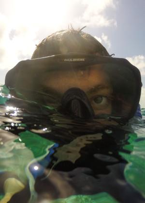 Diver surfaces belize caribbean ocean