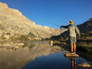 Fisherman casts lake mountains california sierra nevadas