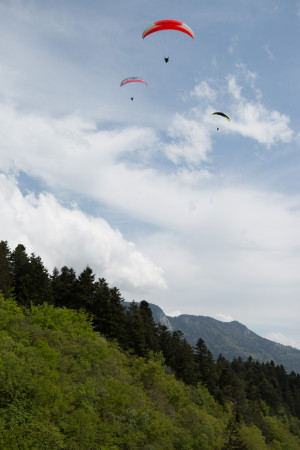 paraglider fly above alps travel france annecy
