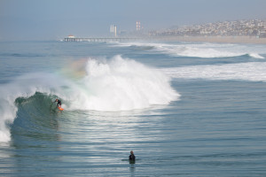 surfer rides wave travel california beach