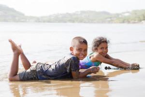 dirty kids play sand beach Nicaragua