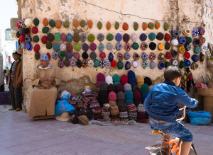 Street scene in morocco child biking hat vendor