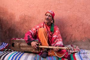 Gnaoua street musician plays in medina of marrakech