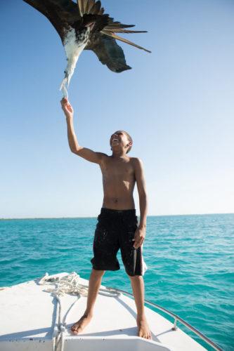 Boy_Feeding_Seagull_Carribbean_Belize