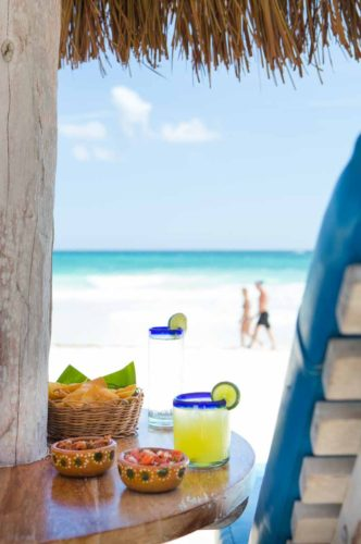 cocktails-appetizers-on-beach-resort-photo