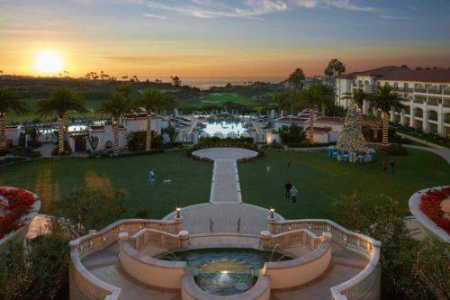 Luxury_beachfront_hotel_grounds_sunset
